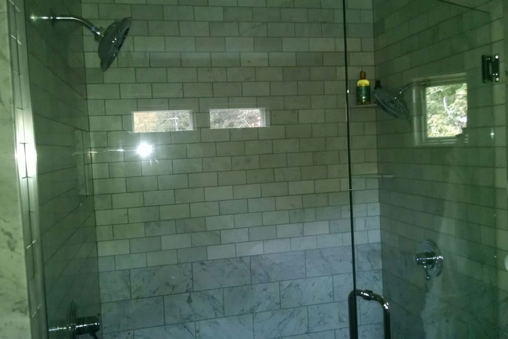 Floor to ceiling marble shower for two.