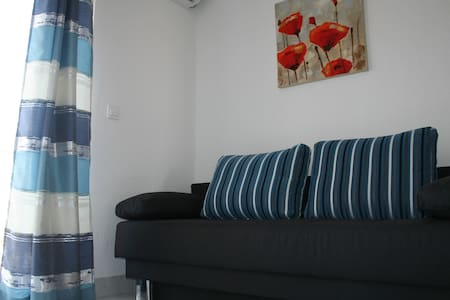 -Apartment with one bedroom, bathroom, kitchen with balcony and a nice terrace with a beautiful sea view -607m from the beach -19km from Zadar -Nice and quiet neighborhood without traffic ideal for family