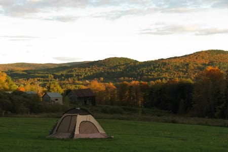 Laurelin Retreat is 50+ magical acres in central Vermont. Bring your tent and gear, camp in our fields, woods, or mossy clearings. We have tent sites, fire pits, portapotties, outdoor hot/cold shower. No indoor facilities, tents, or gear provided.