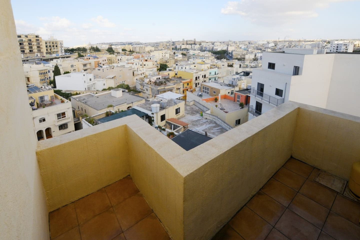 Your private balcony overlooking Msida and Valletta