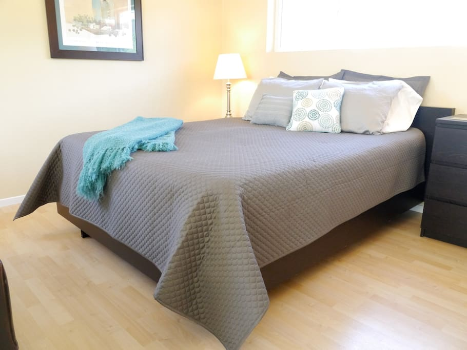 comfortable queen bed with nightstands on each side with good light for reading