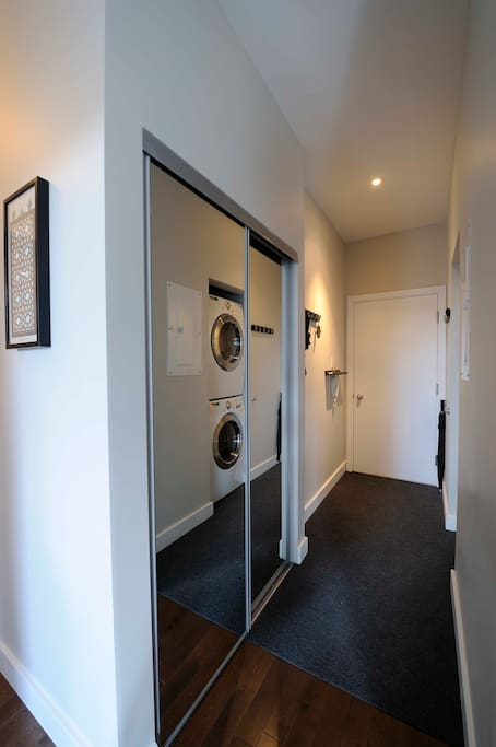 Entrance with stacking washer/dryer