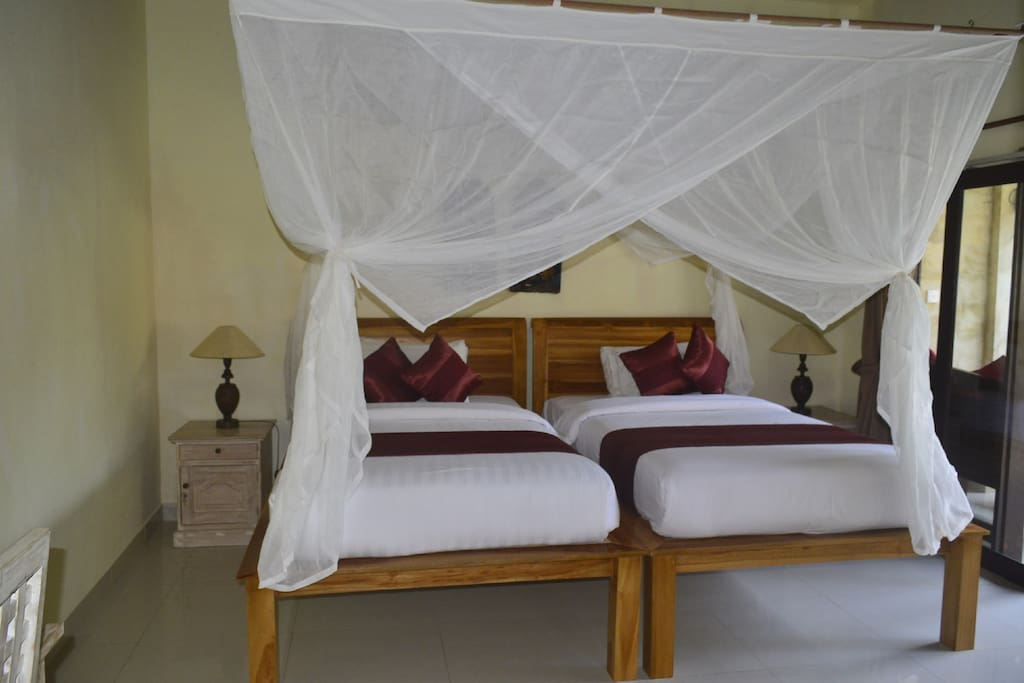 The Twin bed with comfortable Mattrasses and mosquito net.