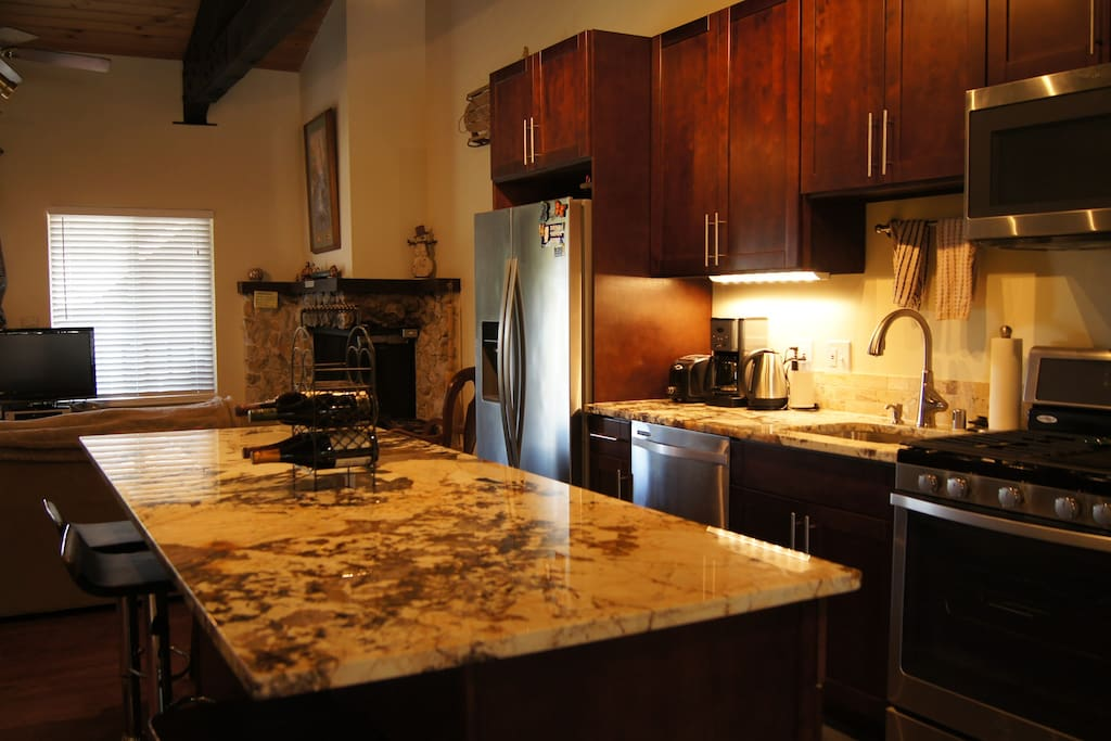 Brand new kitchen with all new stainless steel appliances and contemporary design