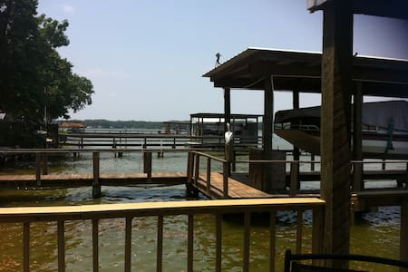 Lakefront home with large deck.