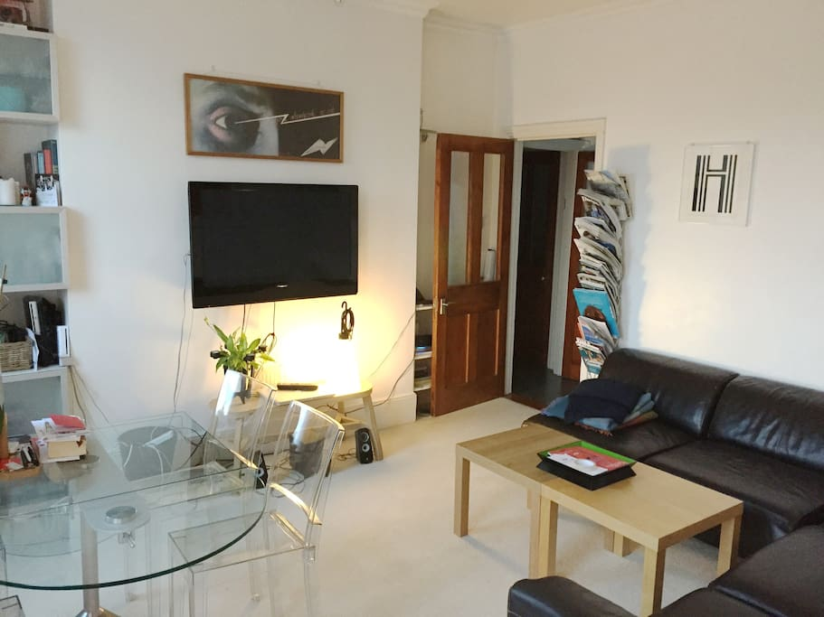 Very bright living room with TV
