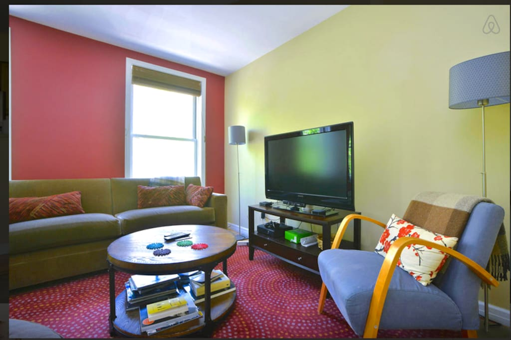 """Close up of the the living room seating area: 42"""" TV, Apple TV and Wii Kinect."""