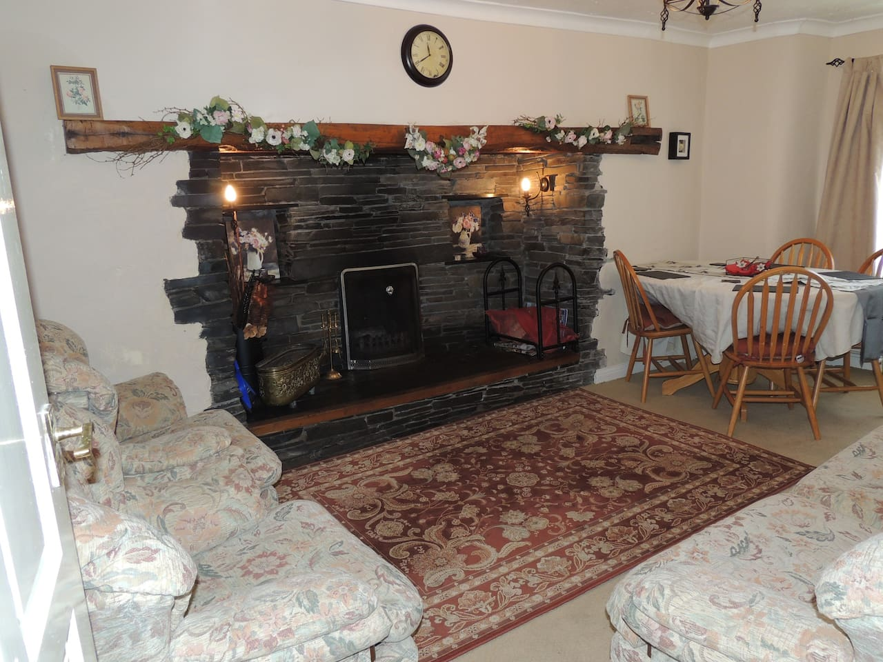 Cosy living room with real working, slate fireplace. Free firewood available.