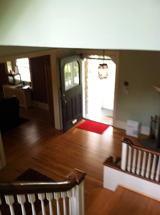 View of foyer from staircase.  Notice the built in bench at the bottom of the staircase.
