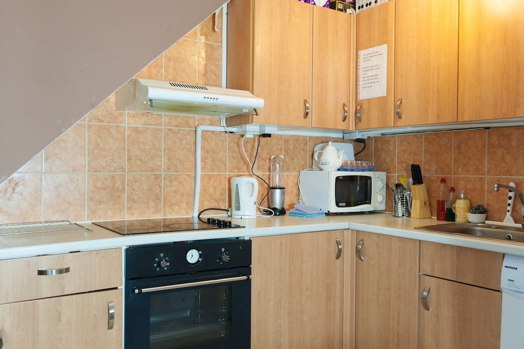 Kitchen with cooker and microwave oven