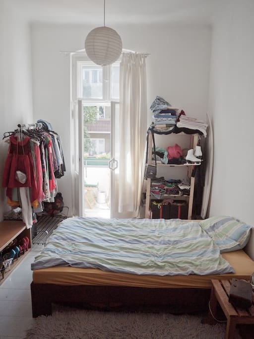 Bedroom that opens up to the balcony. I will make enough space to hang and store your clothes.