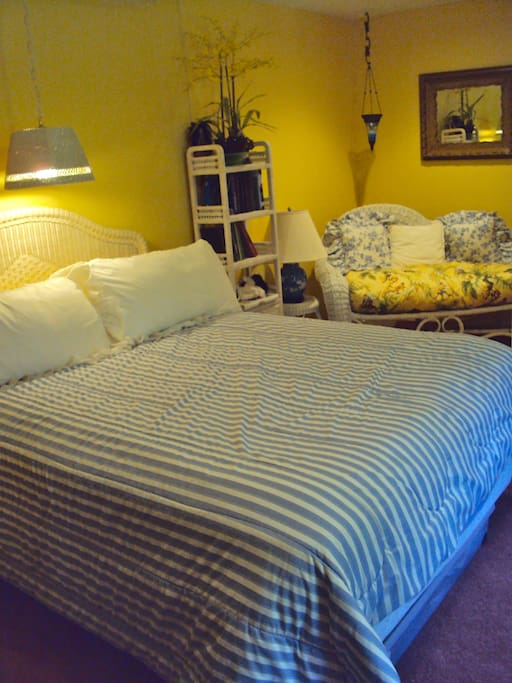 Private Queen Sized bed with sitting area!