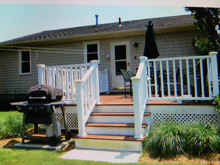 Back deck with gas grill and seating
