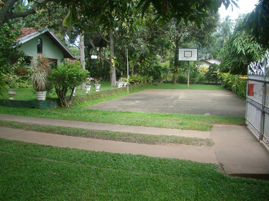 Basket Ball Court & the Badminton court at the front yard of Villa Shade Guest House