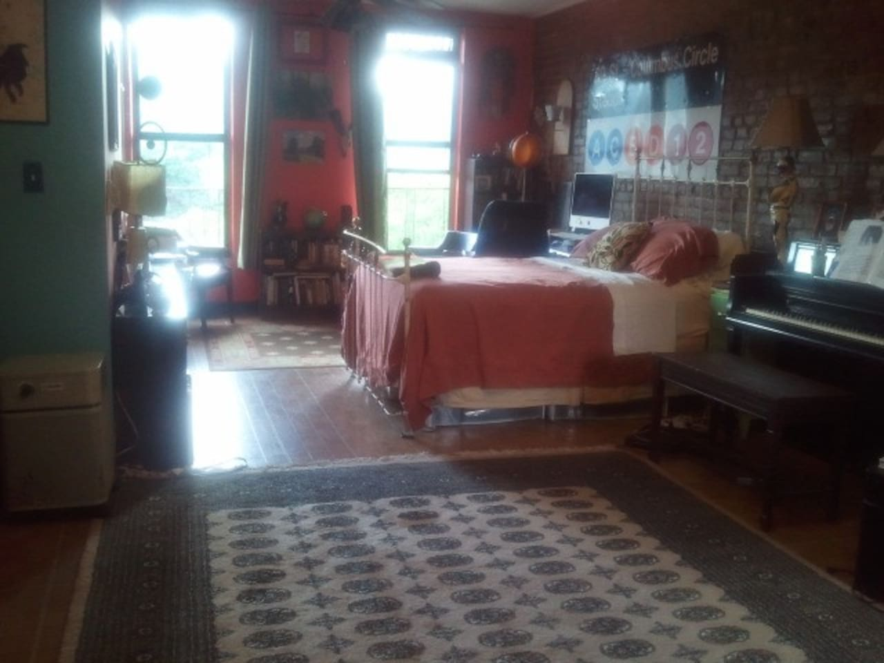 the room is virtually your own studio apartment. Exposed brick and antique furnishings add to the relaxing feel.