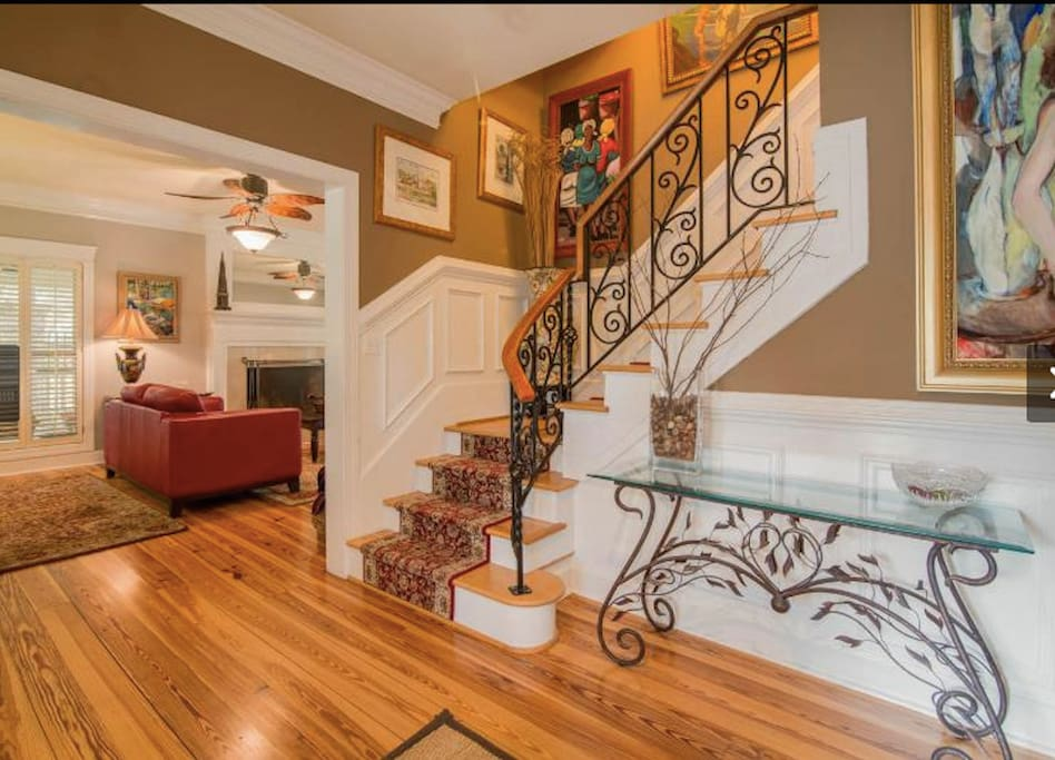 Stylish entry way with larger family room to the left.