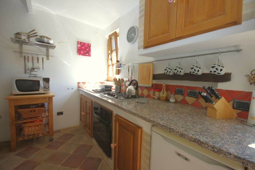 Traditional fitted kitchen with granite counter tops.