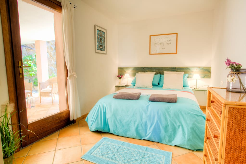 Double bedroom with doors onto private covered terrace