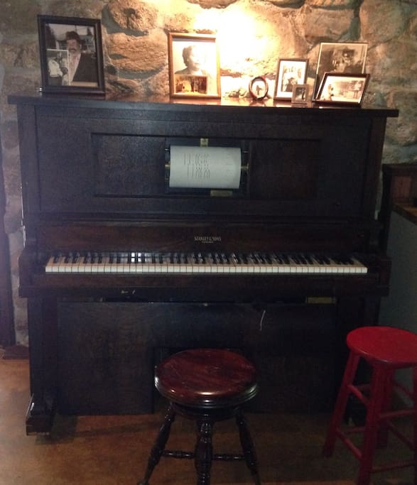 Our 1920's era Stanley player piano is in the kitchen.