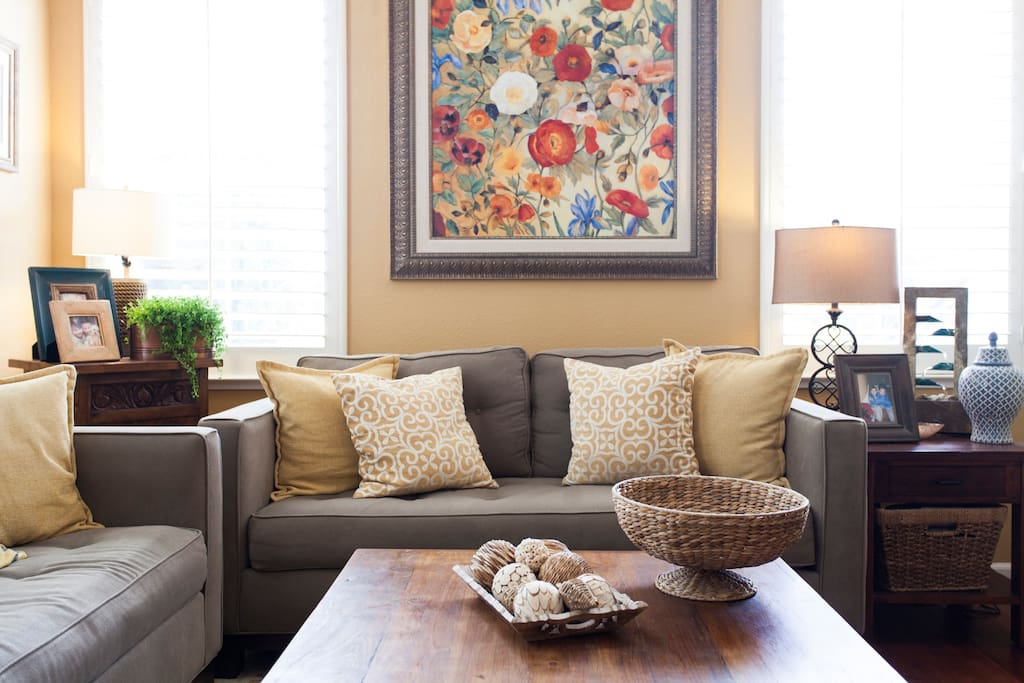 The bright and spacious living room is perfect for relaxing with friends or family