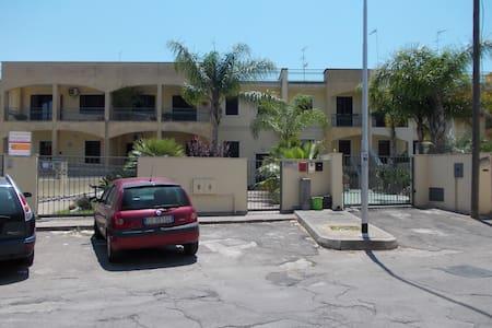 Casa vacanze a Carmiano - Condominium