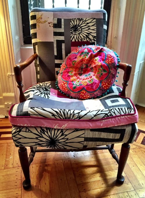 Living room chair lovingly reupholstered--with scraps of fabric I collected over the course of a year.