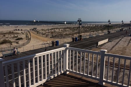 Magnificent ocean view on the Ocean City, NJ Boardwalk. Two bedrooms.  One with queen, one with 2 twins and sofa bed in living room.  1 bath, kitchen, beach front deck.  Second floor apartment.  Fully renovated.  All new for 2015.  Pool nearby.