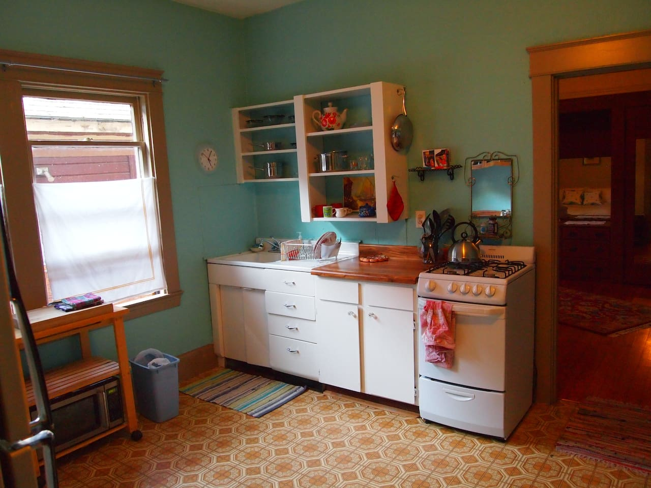 Sweet vintage kitchen with little gas stove, utensils, cookware, you should be able to really make use of this kitchen if you're so inclined.