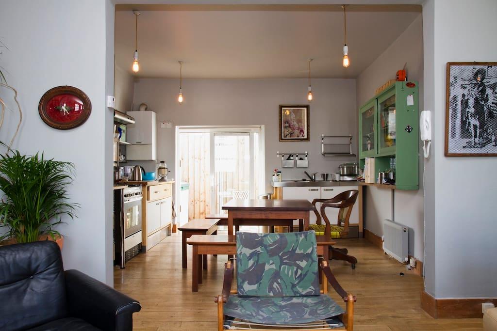 Lounge, kitchen & door to outdoor terrace