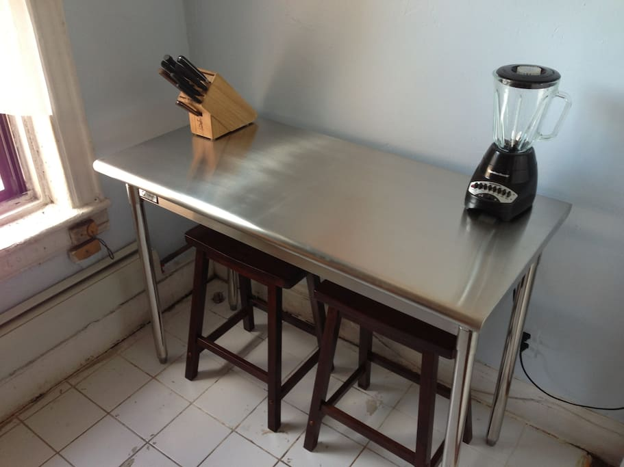 The kitchen also features a stainless steel chef's prep table for all your culinary needs.