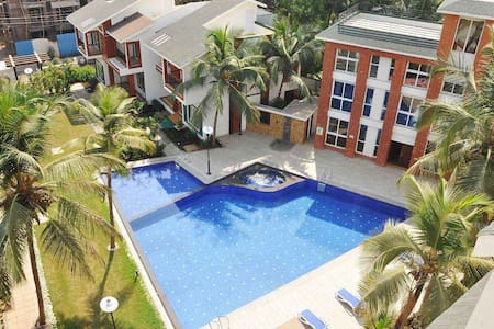 Hans Asia Exotica Luxury Self Service Apartments * 1 Bedroom, Hall, Kitchen A/c Apartment in a Premium Complex * 3 minutes drive from Calangute, Baga and Anjuna Beach * Swimming Pool, Jacuzzi, Gym, Games Room * Daily Cleaning/Housekeeping