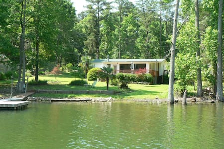 Newly renovated in 2014! Wonderful 2 BR /2 bath home is perfect for a Lake Murray vacation. Master bedroom has a queen and full bed, Second bedroom contains a queen bed.  An air conditioned sleeping porch has two single beds.  Close to Chapin, SC