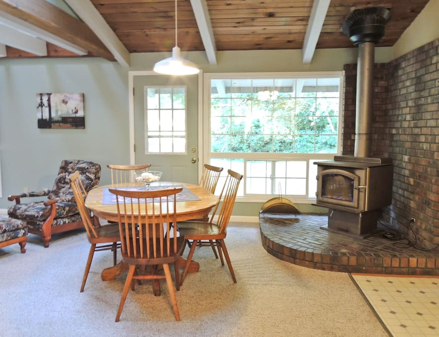 Dining area and a cozy wood stove for cool evenings.