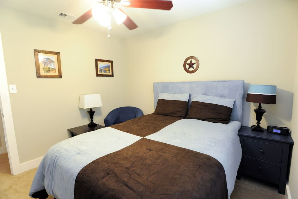 Room includes reading area and alarm clock that is iPhone friendly.