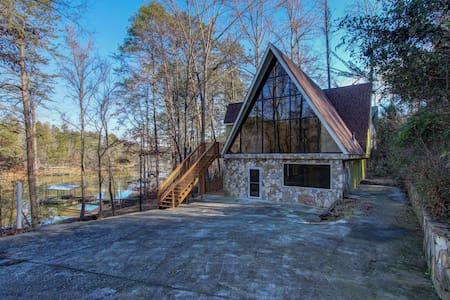 Lanier Laptime, Unconventional Lakefront Living - House