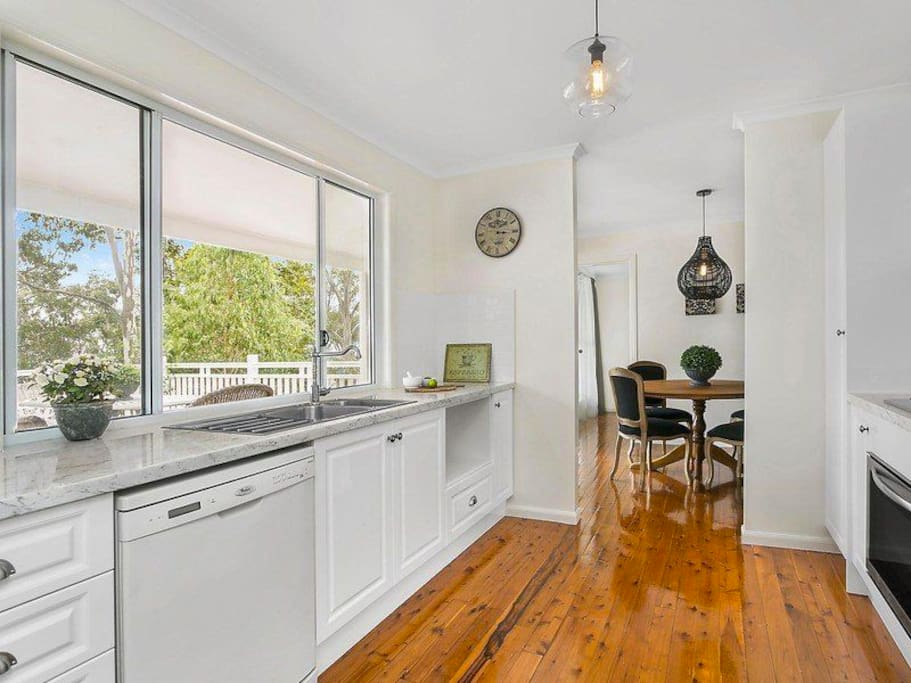 Modern and stylish kitchen adjoining separate dining room.