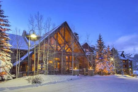 Bear Creek Lodge at Mountain Village is situated adjacent to the Telluride Ski Resort. Use of the Lower Village Bypass run and a semi-private lift provide access to the slopes within in minutes. The 31 condominiums, ranging from one to four bedrooms, all include a gas fireplace and newly remodeled kitchen with granite countertops and stainless steel appliances. It also offers a free shuttle to anywhere in Mountain Village as well as wireless internet, a fitness center, indoor and outdoor hot tubs, an outdoor heated pool, and a sauna. The accommodations are the perfect option for guests family or group Telluride vacation. Hotel rooms also available.  Business Licence #014927  Enter this condominium unit on the forth floor and walk into the open dining area and living room with a gas fireplace, flat screen TV and balcony facing the mountainside forest view. The living room is open to the kitchen with granite countertops and a breakfast bar with seating. On the main level is a bedroom with a king bed, TV and an ensuite bathroom with jetted tub and separate shower. The second bedroom on the main level has a king bed that can be split into two twin beds, TV and a bathroom in the hallway with shower/tub combo. Upstairs is the master bedroom with a king bed and queen sleeper sofa, TV, walk-in closet and ensuite bathroom with double sinks, jetted tub and separate shower. There is also a safe in the master bedroom. On this floor is another bedroom with king bed that can be split into two twin beds, TV, walk-in closet and ensuite bath with jetted tub and separate shower.   Photos are representative of the property and may differ from the actual unit that is reserved.