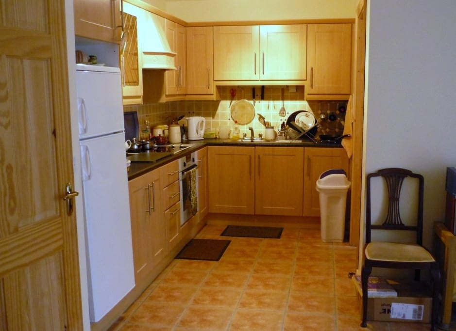 Kitchen and utility area (thru door on right)
