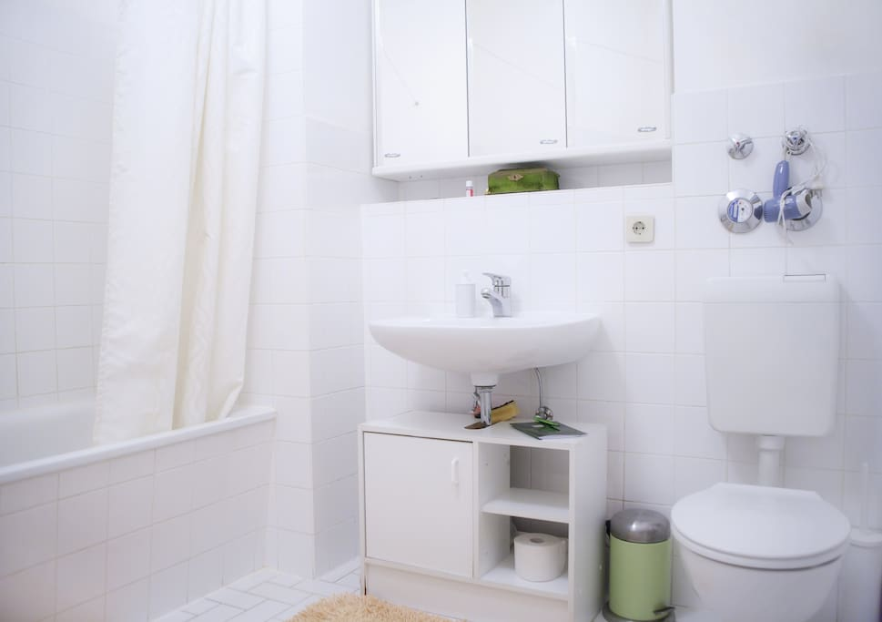 The bathroom is pretty big and complete with a hot tub/shower and a washing machine for your laundry.