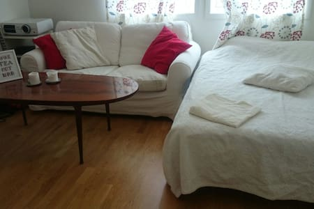 Our second bedroom is 15m2, incl. bed and sofa, windows towards the garden in a calm, residential area We are a young couple living here. The city centre of Ås, train and bus station is just a short walk. There are some lovely forest areas close by!