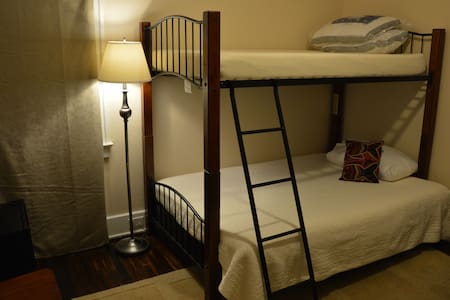 Cozy Bunk Suite + Shared Bath! Book by 10pm & we reply within 20 min. Late arrival OK. Self-check-in with keyless entry. Fridge, microwave & coffee maker. Safe area. Driveway parking. 15 min downtown. Maps, tips & foodie faves. We live here to help!
