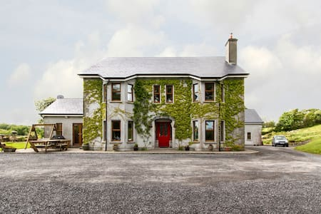 The Garden Gates is a 5 star country bed and breakfast (b&b) is nestled between the towns of Westport and Castlebar in the heart of Co. Mayo, Ireland.  This is a spacious bedroom with large bed and ensuite bathroom.