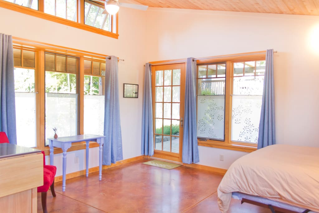 Windows galore! Privacy shades and curtains facilitate your own private nook amidst the garden views.