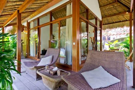 Luxury thatch cabin in eco-resort