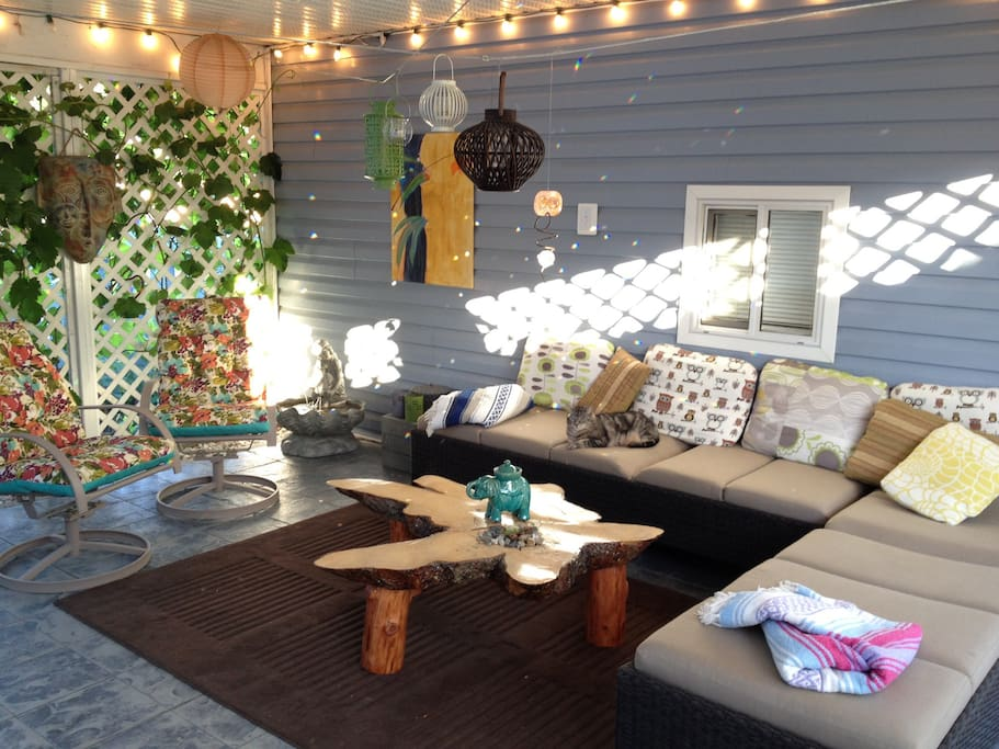 Your outdoor room - loungers, clotheslines, grape vine...white lights plug in the left corner
