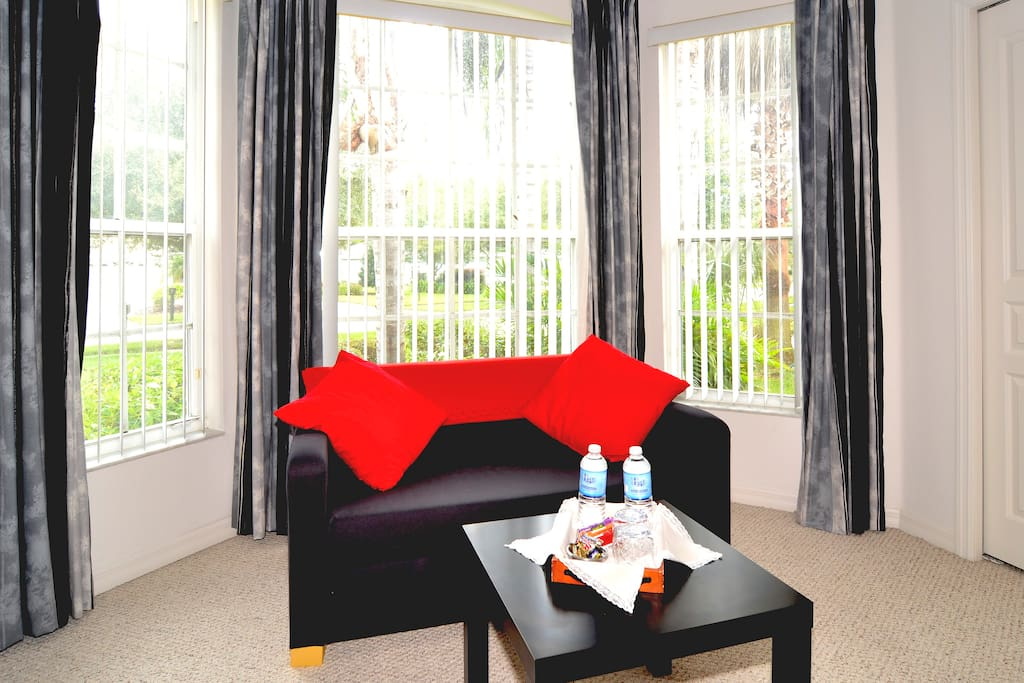The downstairs queen suite has a cosy sofa for reading - water and granola bars daily