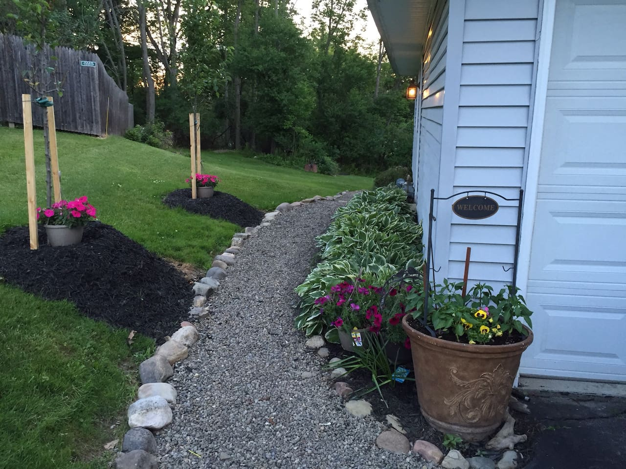 Stepping stone path along side house to your private rear entrance.
