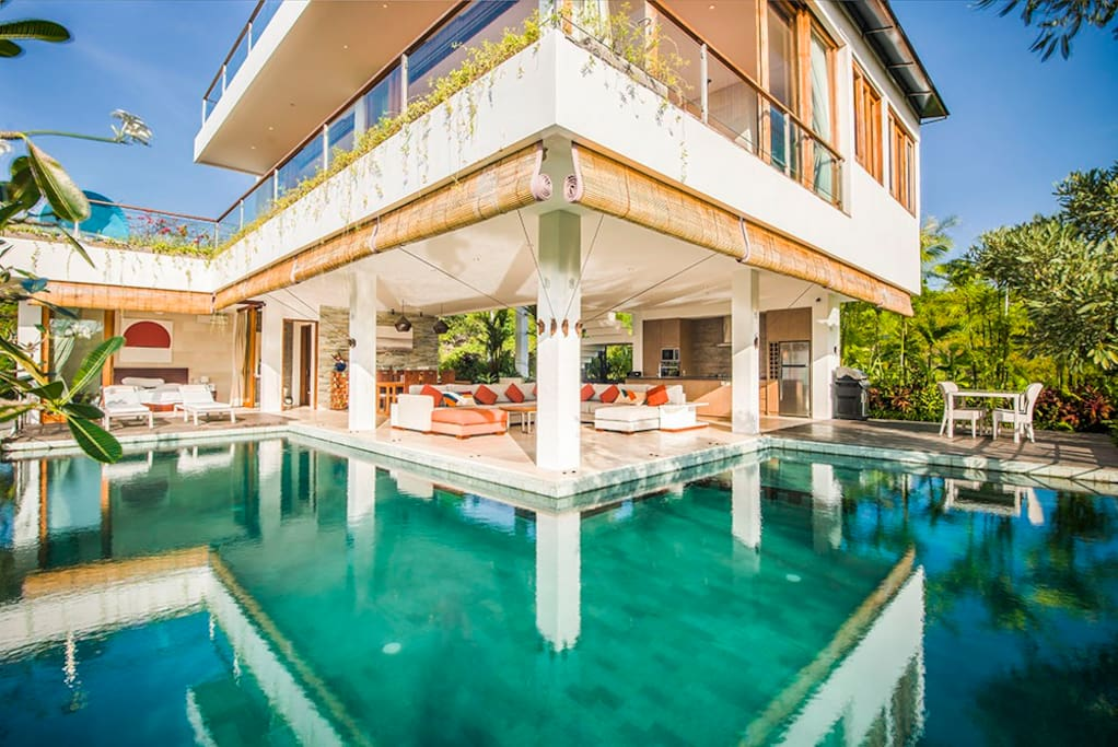 L-Shaped Infinity Swimming pool (12metres by 9metres) wrapping around the lounge / dinning area
