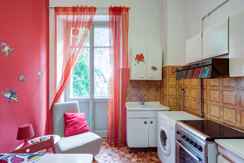Kitchen with Washing machine and Balcony Access!