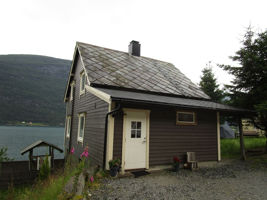 The house. On the right side there is a recreation area. On the left side there is a beatiful terrace by the fjord.